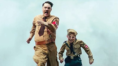 Taika Waititi (left) and Roman Griffin Davis skewer fascism in Waititi's Jojo Rabbit.