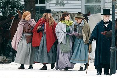 Eliza Scanlen, Saoirse Ronan, Emma Watson, and Florence Pugh as the March sisters in Little Women.