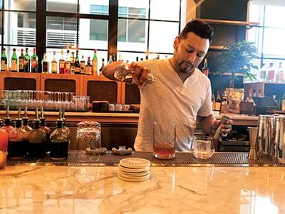 Pablo Mata, lead bartender at Arrive's Bar Hustle - PHOTOS BY LORNA FIELD