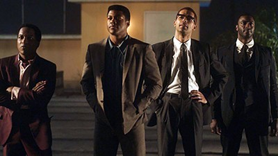 Sam Cooke, Cassius Clay, Malcolm X, and Jim Brown walk into a hotel — (l-r) Leslie Odom Jr., Eli Goree, Kingsley Ben-Adir, and Aldis Hodge star in Regina King's One Night in Miami.