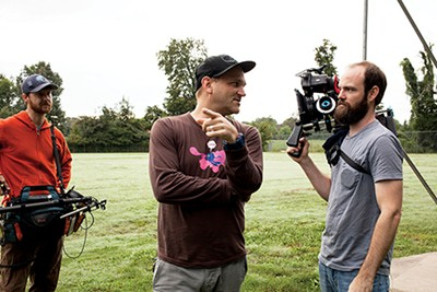 Morgan Jon Fox consults with cinematographer Ryan Earl Parker on a shot as sound man Brandon Robertson looks on - BREEZY LUCIA