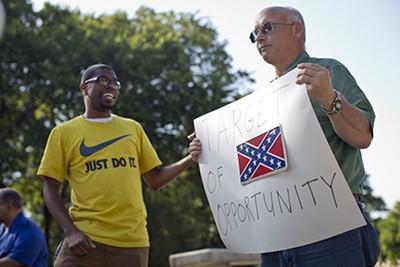 A protestor taunts a Forrest loyalist. - JUSTIN FOX BURKS