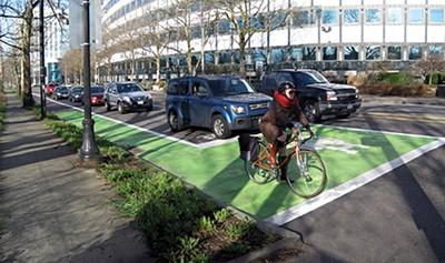"A ""bike box"" like this one in - Portland, Oregon, will be  painted at the intersection of Cleveland and Peabody. - NATIONAL ASSOCIATION OF CITY TRANSPORTATION OFFICIALS"