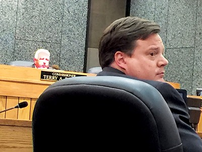 Chairman Roland and County Attorney Ross Dyer seemed focused on another matter here, but they were much on each other's mind on Monday. - JACKSON BAKER