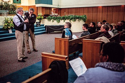Tom Carlson and Randall Mullins address the Responding to Racism group at the New Olivet Baptist Church