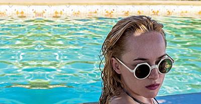 Dakota Johnson dons Lolita sunglasses in A Bigger Splash.