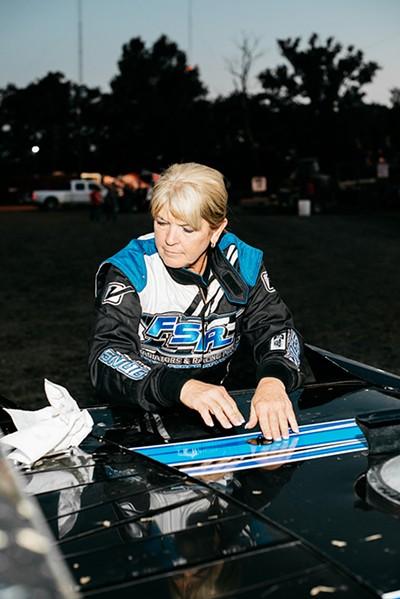 Linda Kerbough works on her stock car.