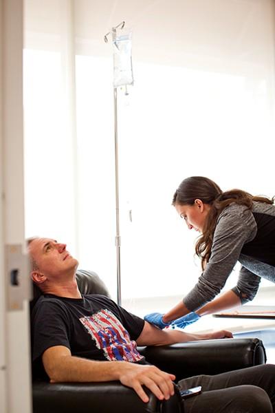 Flyer film editor Chris McCoy gets IV hangover therapy. - JUSTIN FOX BURKS