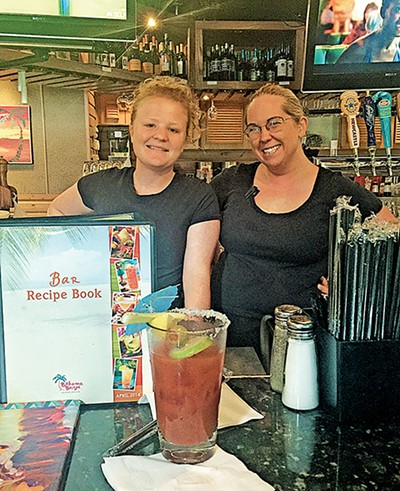 Bartenders Jessica Tyler and Michelle Dickson of Bahama Breeze with a freshly garnished (and sampled) Bloody Mary.