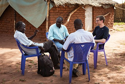 Mark Hackett speaks with education officials in the Yida Refugee Camp.