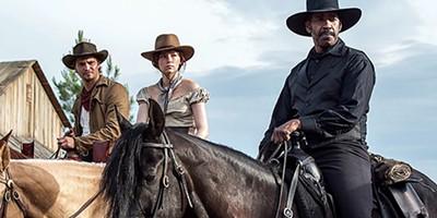 Luke Grimes (left), Haley Bennett, and Denzel Washington saddle up.