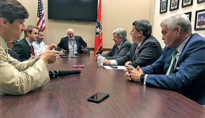 The state Senate's Republican leaders - (l to r, right side of table: Speaker Randy McNally, - Majority Leader Mark Norris, and Speaker Pro Tem Jim Tracy) - get some pressure from the press.