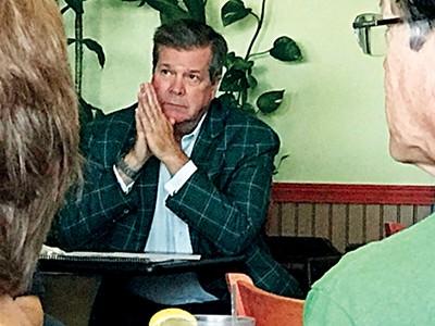 Karl Dean waits turn to speak at a Democratic meeting - JACKSON BAKER