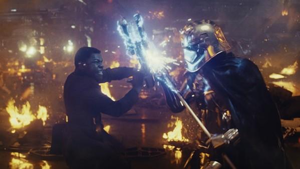 John Boyega and Gwendoline Christie do battle in The Last Jedi.