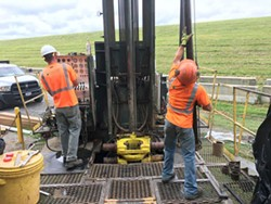 TVA workers install water quality monitoring wells near the Allen Fossil Plant. - TENNESSEE VALLEY AUTHORITY