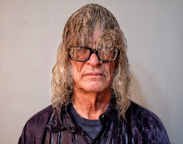 What Michael Donahue might have looked like if he didn't have an umbrella while covering seven parties in a row. - JON SPARKS