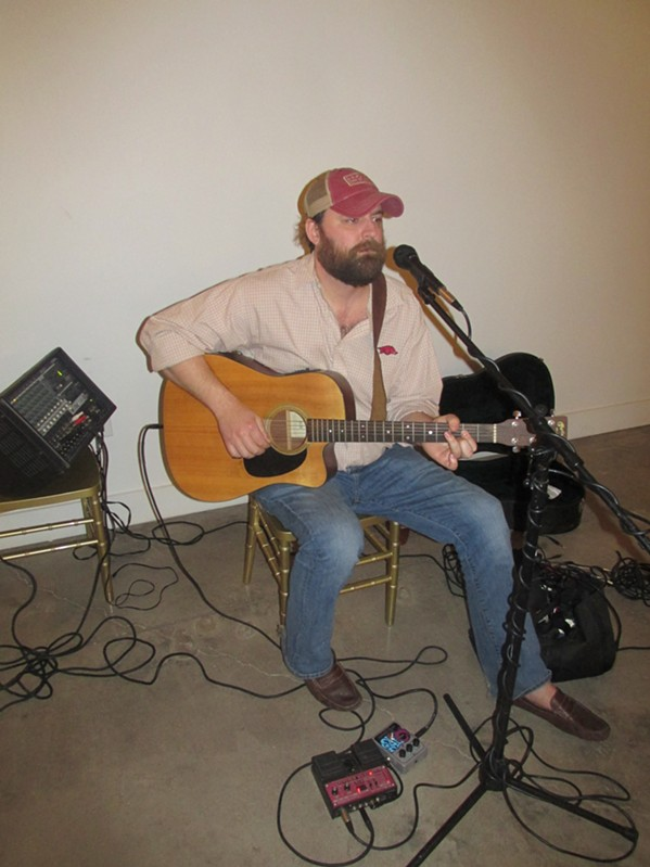 Dougan Grimes sings and plays guitar at Avon Acres. - MICHAEL DONAHUE