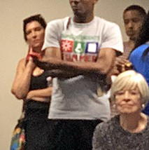South Africa native Ann Rief (at left) made the meeting's most passionate  request for change, then bashfully withdrew  to the periphery, shunning further attention. - JB