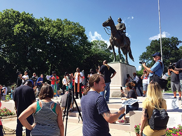 Crowds gathering in Health Sciences Park to support the removal of the Nathan Bedford Forrest statue.