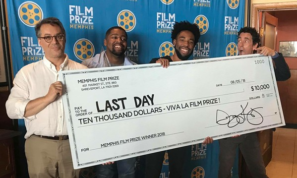 """Kevin Brooks (third from left) accepts the Memphis Film Prize he won for his short """"Last Day"""". From the left is Film Prize Filmmaker's liaison David Merrill, """"Last Day"""" star Ricky D. Smith, Brooks, and Louisiana Film Prize founder Gregory Kallenberg. - COURTESY MEMPHIS FILM PRIZE"""