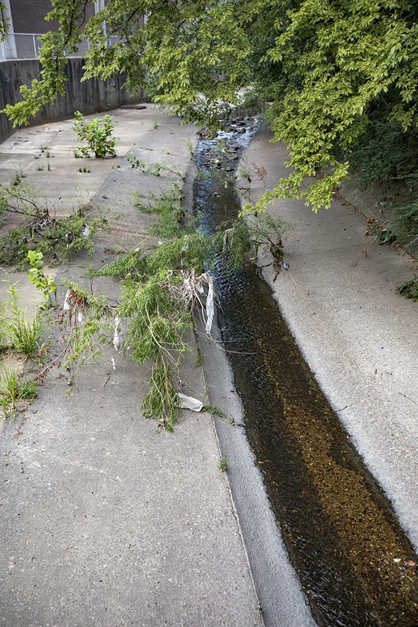 The Cane Creek drainage ditch carries Depot runoff directly through the grounds of Hamilton High School.