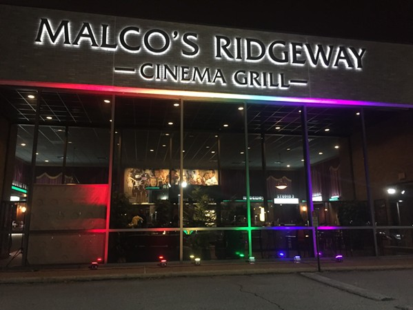Malco Ridgeway Cinema Grill lit up with the LBGTQ rainbow for the Outflix Film Festival. - ALANNA STEWART