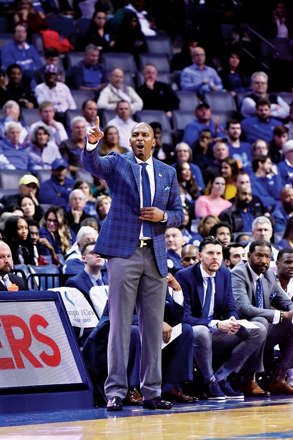 Tigers Coach Penny Hardaway leads from the sidelines.