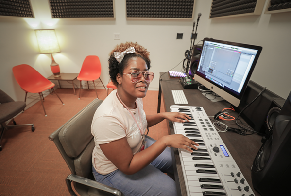 A musician works in the sound lab - CROSSTOWN ARTS