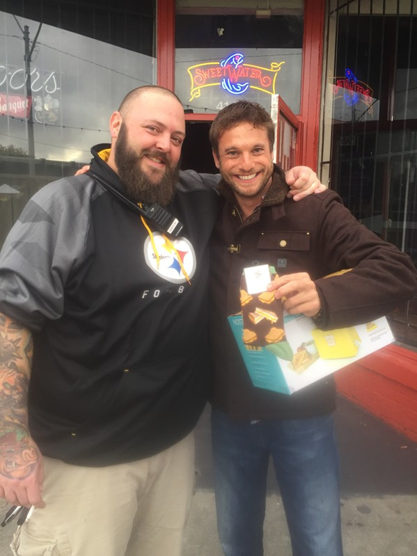 """Bram Bors Koefoed won a toaster and a pair of socks in the grilled cheese eating contest at the Memphis Grilled Cheese Festival. With him is Brian """"Skinny"""" McCabe. - MICHAEL DONAHUE"""