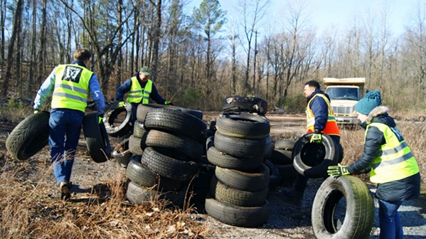 Volunteers stacking collected tires at T.O. Fuller Park - FACEBOOK- MICHAEL MEISTER