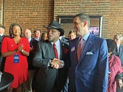 Governor Bill Lee addresses the crowd at the War Memorial Auditorium in Nashville (top); Antonio Parkinson shakes hands with Lang Wiseman (below). - JACKSON BAKER