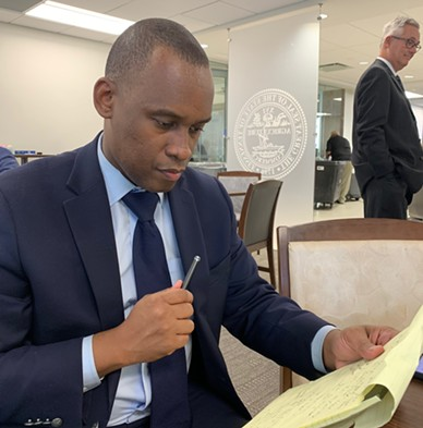 Greenspace president Van Turner looks over legal notes. - JB