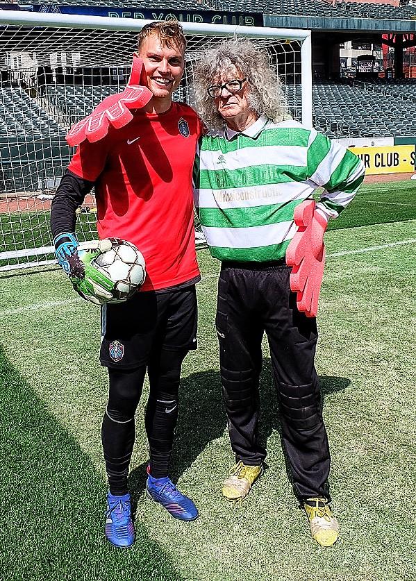 """A goalie and a """"goalie."""" - JON W. SPARKS"""
