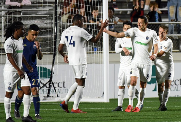 Marc Burch celebrates scoring a penalty with Rashawn Dally - 901 FC