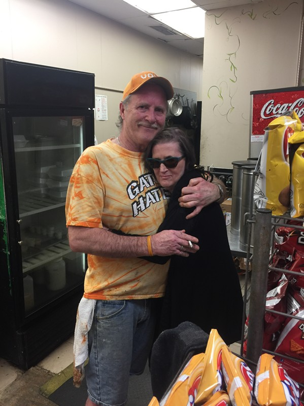 Beckii Lee gives Brad Peden a hug on his last day at Court House Deli. - MICHAEL DONAHUE