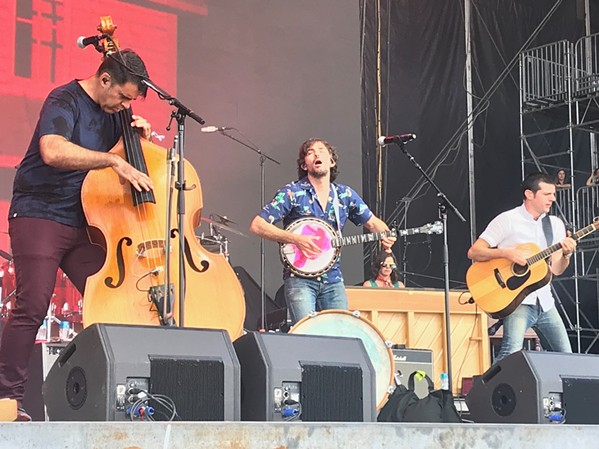 The Avett Brothers put on a lively show on the Which Stage Friday afternoon. - BIANCA PHILLIPS