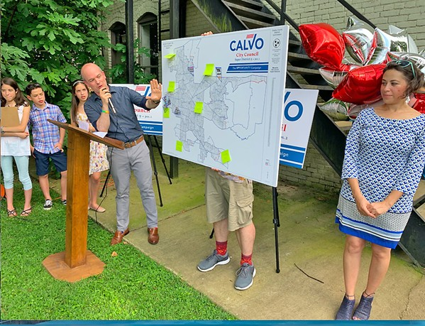 Council candidate Mauricio Calvo, running in the race for Super-District 9, Position 2, was flanked by family members at a Thursday afternoon rally in Midtown, as he delineated the neighborhoods in his district via a chart held by a supporter. - JB
