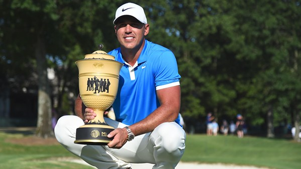 Brooks Koepka takes the trophy in Memphis. - CBS SPORTS