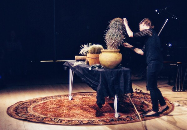 "Jenny Davis plays amplified cacti in John Cage's ""Child of Tree"" at the 2018 Continuum Fest - BEN REDNOUR"