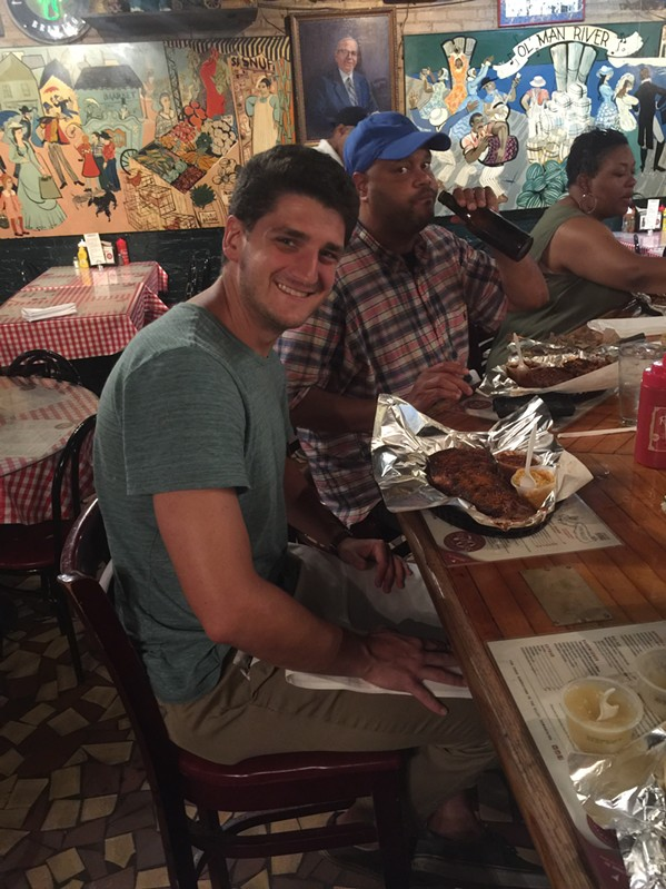 Brian Taylor from Austin, Texas tries his first Rendezvous ribs on his first trip to Memphis. - MICHAEL DONAHUE