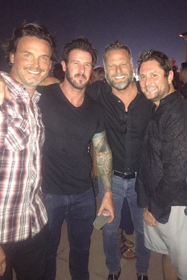 Silas Gaither, Chris Bramlett, Kevin Fair, and Shannon Dyson were at Peabody Rooftop Party. - MICHAEL DONAHUE