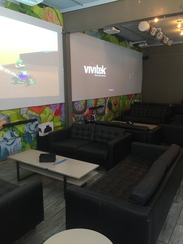 People can play games or watch sports on giant projector screens in comfy living room areas. - MICHAEL DONAHUE