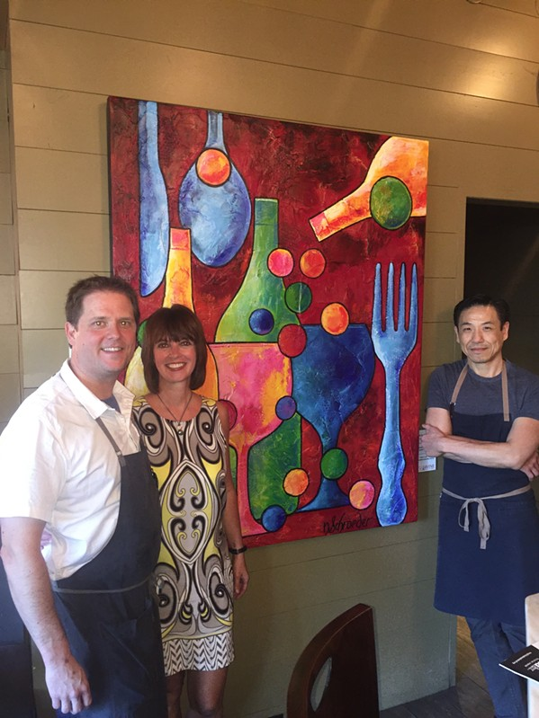 Nikki Schroeder created the official festival art for the Memphis Food & Wine Festival 2019. The painting was on view at an announcement party at Acre restaurant for the festival, which will be Oct. 12 at Memphis Botanic Garden. With her are chef Andrew Adams and chef/owner Wally Joe. - MICHAEL DONAHUE