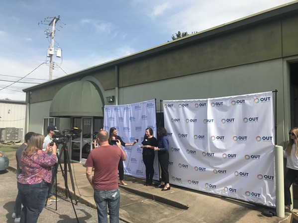 Molly Quinn, OUTMemphis executive director (center left), and Ashley Coffield, PPTNM president (center right), speak during a news conference in front of OUTMemphis' new administrative office building. - TOBY SELLS