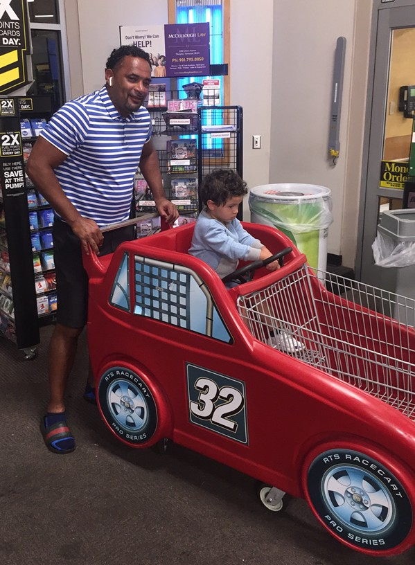 Art Horne and his son, Brooklyn, at Kroger on Winchester. - MICHAEL DONAHUE