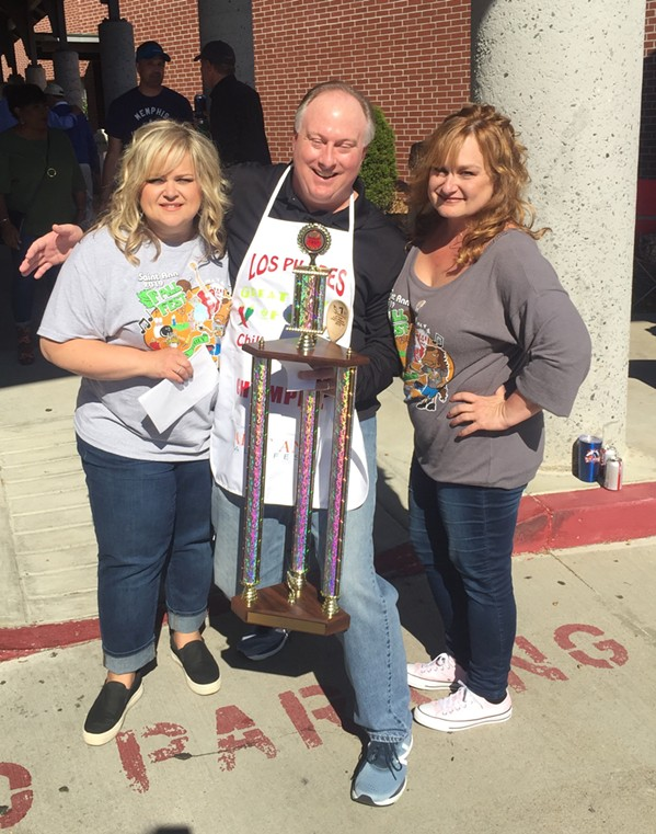 Burns' Chili Wagon took first place honors at the St. Ann Fall Fest Chili Cook-Off, which was held October 18th at St. Ann Catholic Church. Mike Burns is with Jamie Coggins and Stephanie WIlson Nichols. - MICHAEL DONAHUE