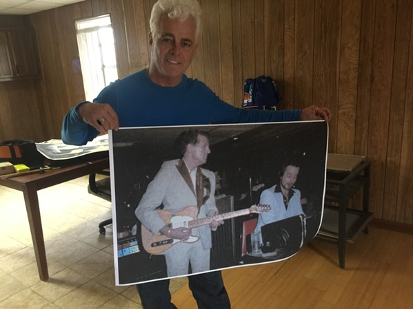 Dale Watson with a photo of Jerry Lee Lewis appearing at Hernando's Hide-A-Way. - MICHAEL DONAHUE