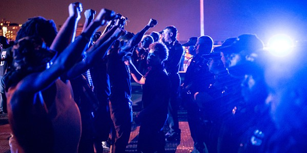 Protesters and police officers face off during the 2016 Hernando de Soto bridge protest - BRANDON DILL