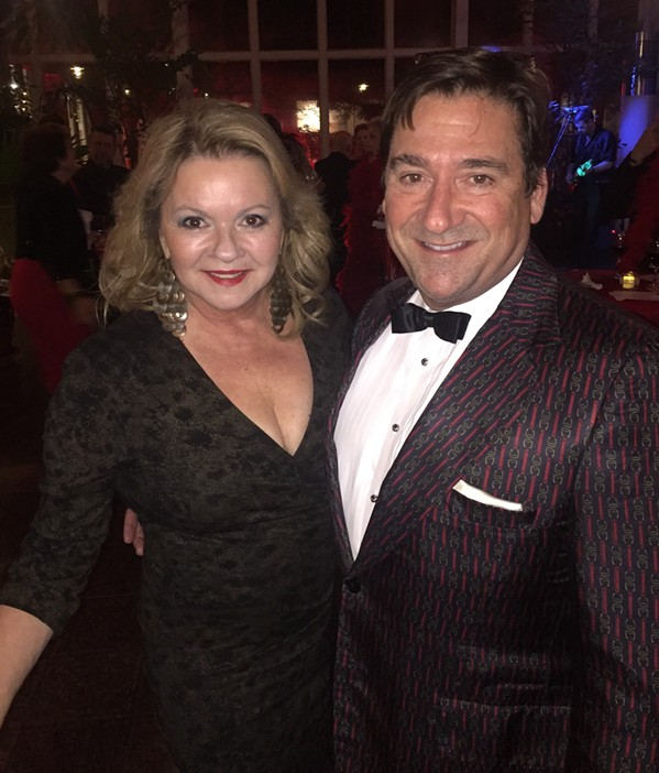 Alice Higdon is retiring her red boa - as far as being Red Boa chair - at  of this year's event, which was  held Nov. 15th at Memphis Botanic Garden. She is with Daniel Reid at the10th annual Red Boa Ball fundraiser for the American Red Cross of the Mid-South. - MICHAEL DONAHUE