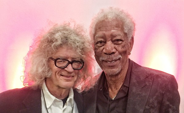 A non-Academy Award winner  wearing glasses with an Academy Award winner at the Moonshine Ball. Morgan Freeman was a guest at the event, held November 22nd. - TREVOR BENITONE